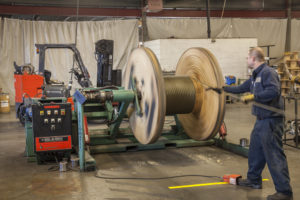 Spooling a length of wire rope